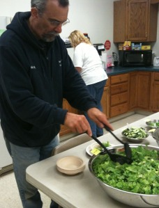 An employee creating his salad
